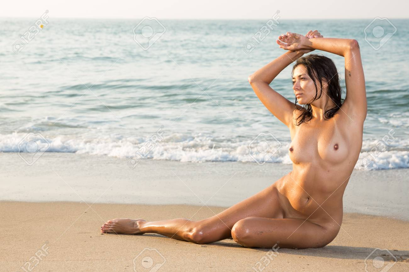 Naked girl in the sand